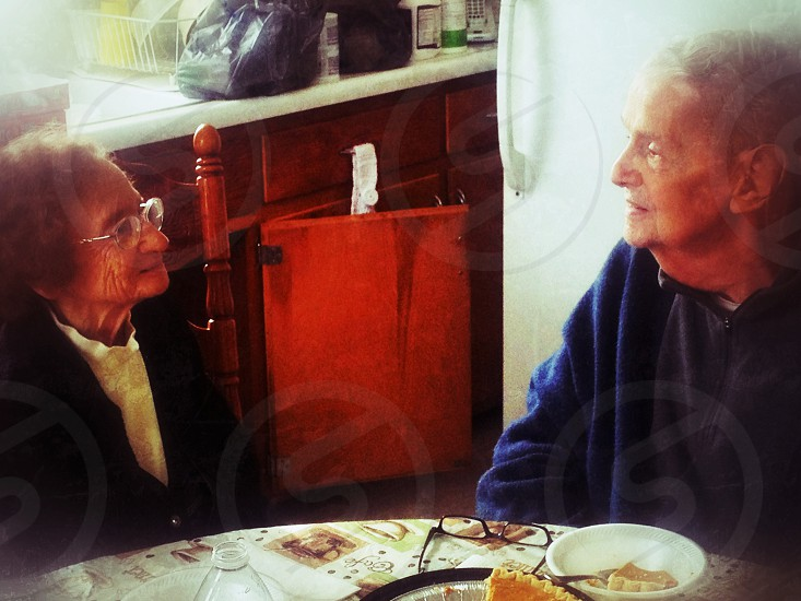 Elderly couple enjoying lunch at home. Grandparents cute lunch home love couple photo