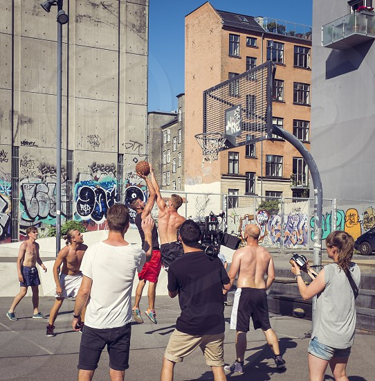 two teams at work: camera crew action  shooting street basketball game photo