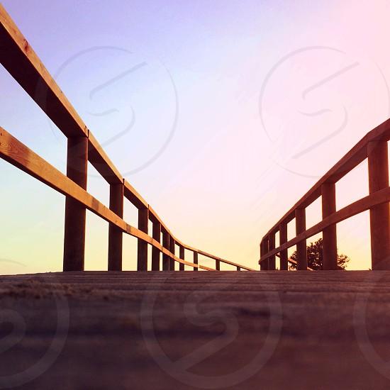 brown wooden bridge railings photo
