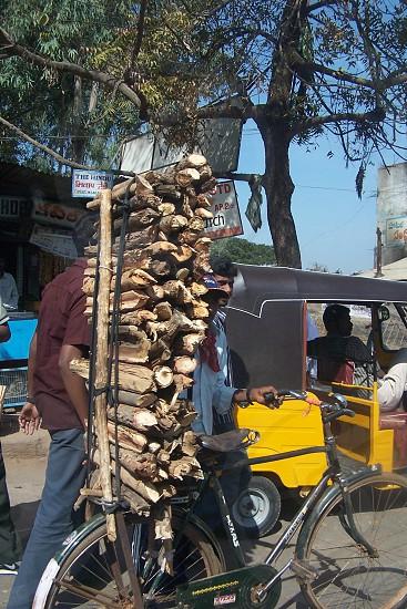 Wood stack bicycle India work photo