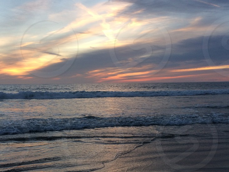 Sunset at the beach in California photo