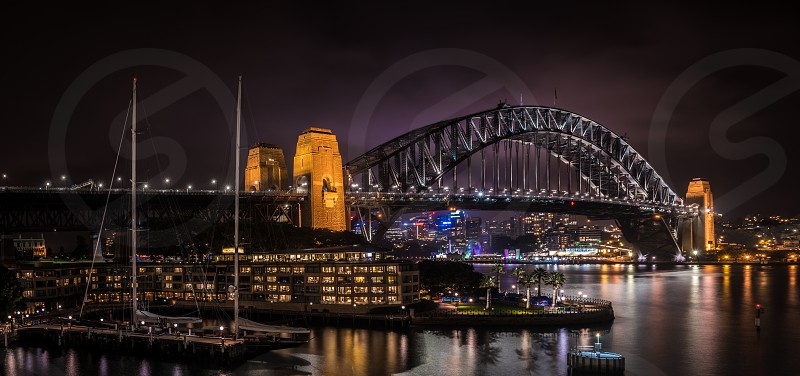 This image was taken at the overseas passenger terminal in Sydney Australia. The image is of the iconic Harbour Bridge which links the Sydney central business district (CBD) with the North Shore commercial and residential areas both of which are located on Sydney Harbour. This is a high res image and would be best suited for large print as there are a lot of details to appreciate. photo