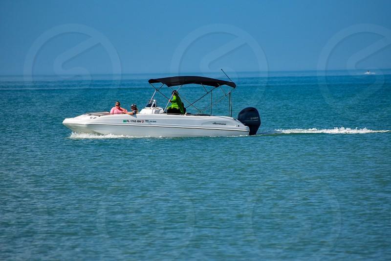 Clearwater Beach Florida. January 25 2019 People enjoying bowrider boat close to Clearwater Marine Beach in Gulf Coast Beaches (2) photo