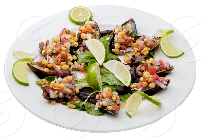 Mexican food plated and shown on a white background. photo