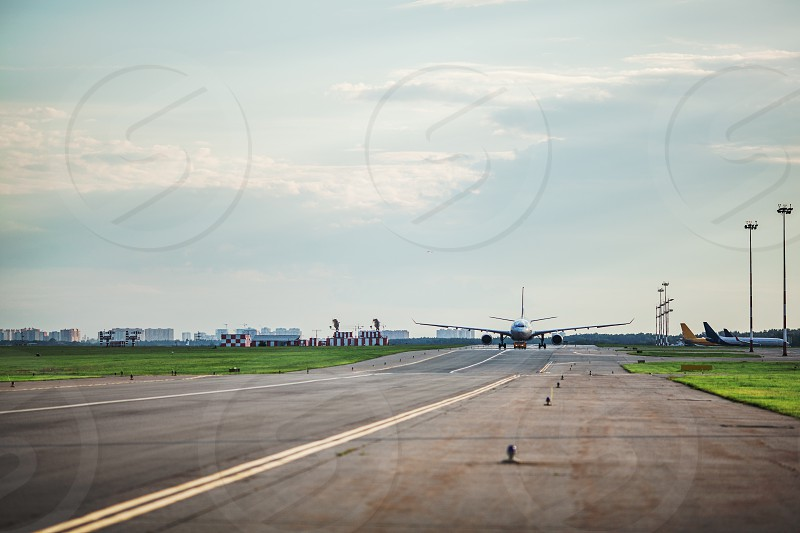 Airplane taxing on the runway is ready for takeoff photo