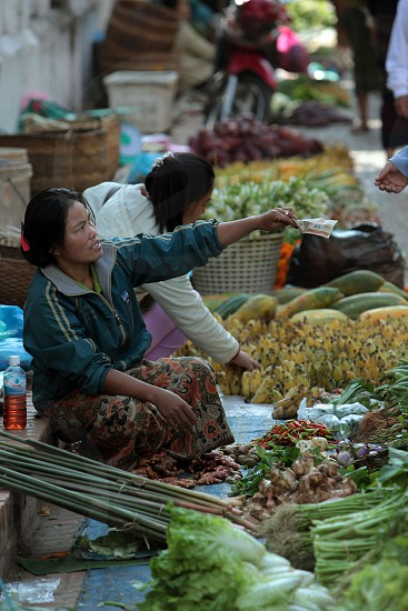 the morning market in the old town of Luang Prabang in the north of Lao in Souteastasia. photo