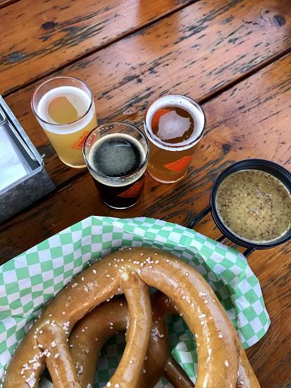 Taste- warm salty pretzels and cold beer photo