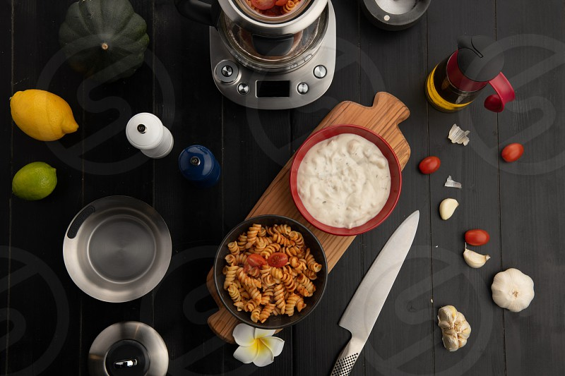 overhead lifestyle food and product photography of pasta dishes photo