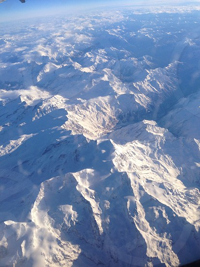 top view of snow covered mountains photo