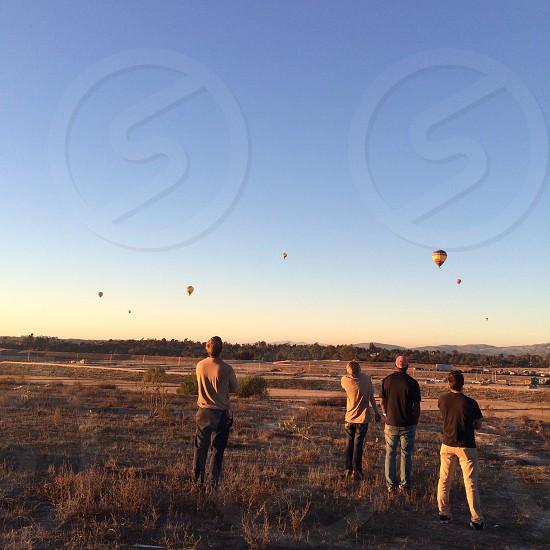 4 man overlooking sky  photo