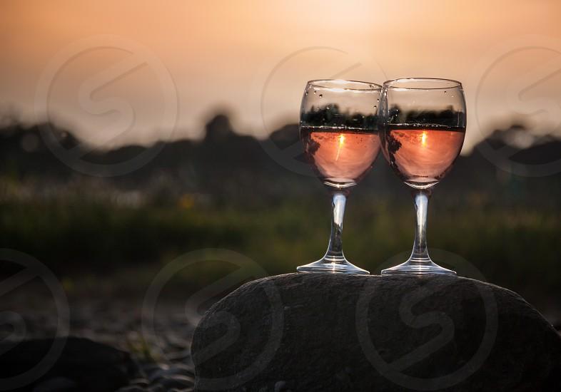 2 wine glass on stone photo