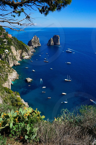 The Faraglioni rock formations and the rear bay of Capri island seen from Belvedere Punta Cannone photo
