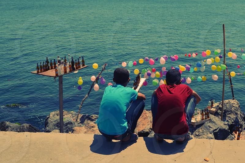 Boys looking at balloon shooting game Istanbul photo