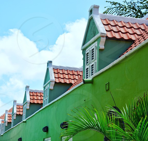 Greenhousesarchitecturefacadespalmwindowsshutterslooking uprooftiles roof wall green color  photo