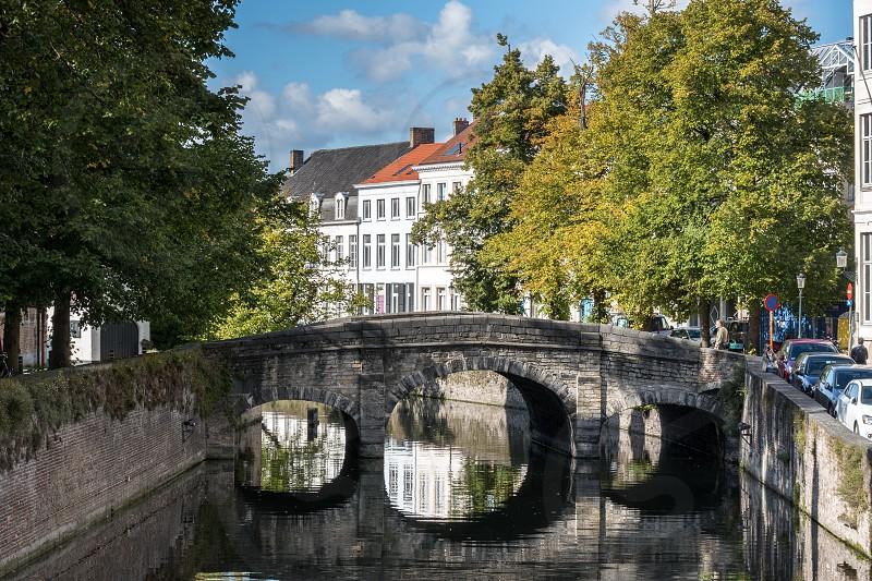 Bridge over a canal in Bruges West Flanders in Belgium photo