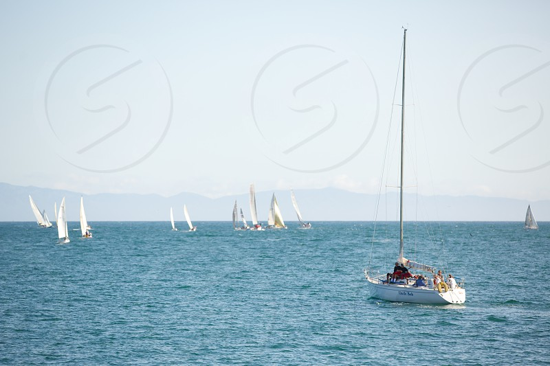 white sailing boat in the ocean photo