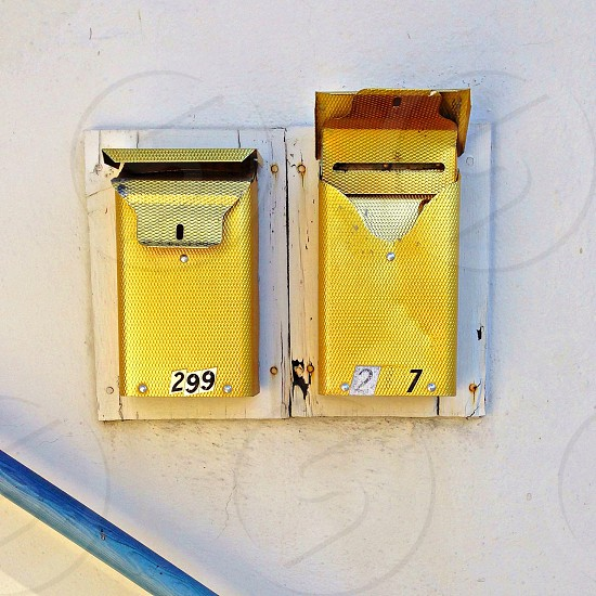 yellow metal wall mounted container photo