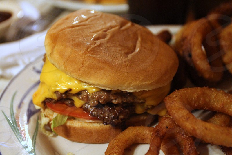 Double cheeseburger with onion rings photo