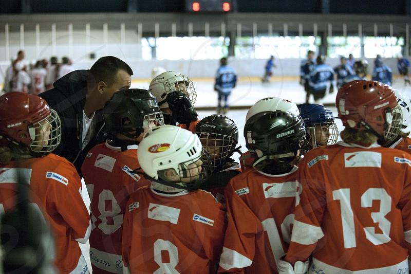 Hockey coach and a team photo