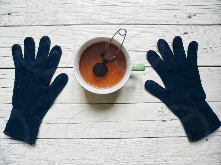 tea white drink mittens gloves photo