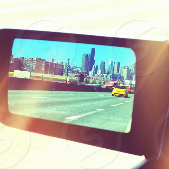 Rear view mirror reflecting a trip! photo