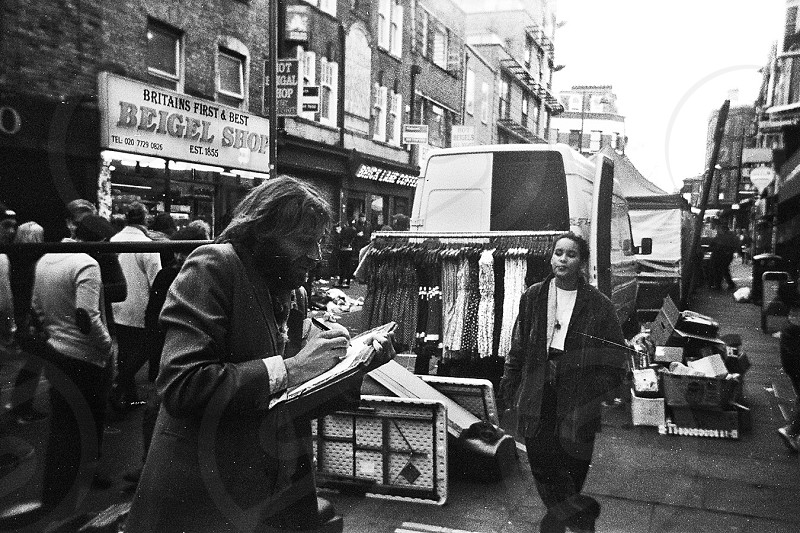 Art street brick lane drawing life black and white film 35mm character painter street photography clothes sale photo