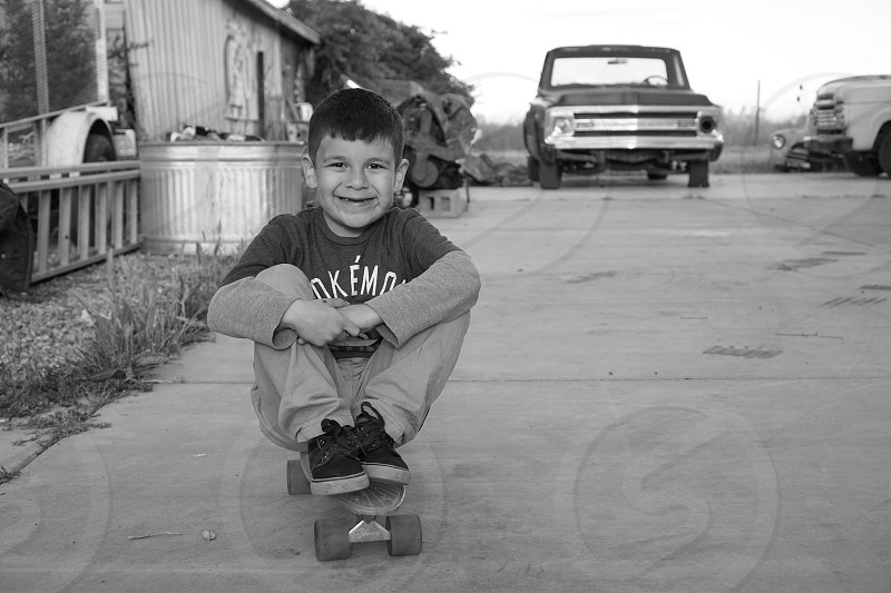 Toddler skateboard black and white portrait photo