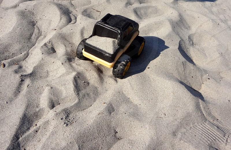 Toy truck in the sand at the beach photo