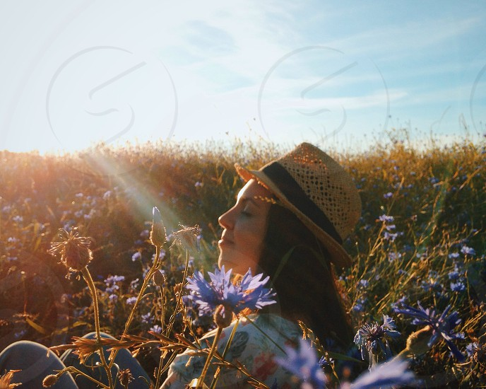 woman with a hat in a flower field photo