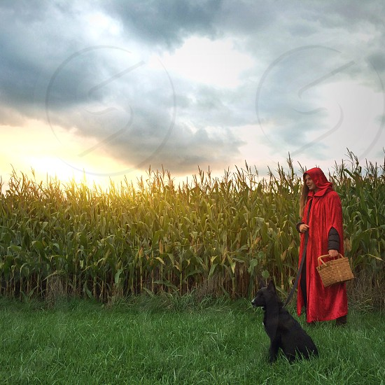 woman in red cape photo
