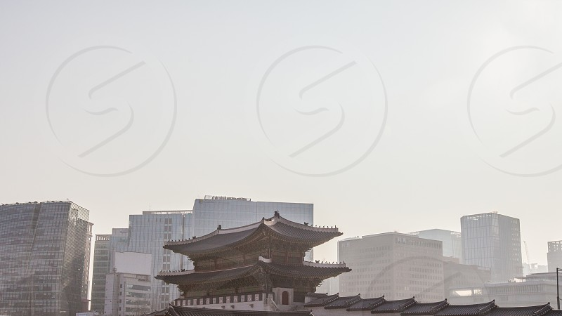 Traditional Asian Architecture in the middle of the Korean city landscape photo