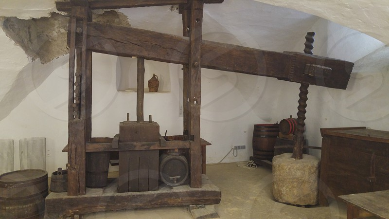 Vintage wine press in a wine cellar. photo