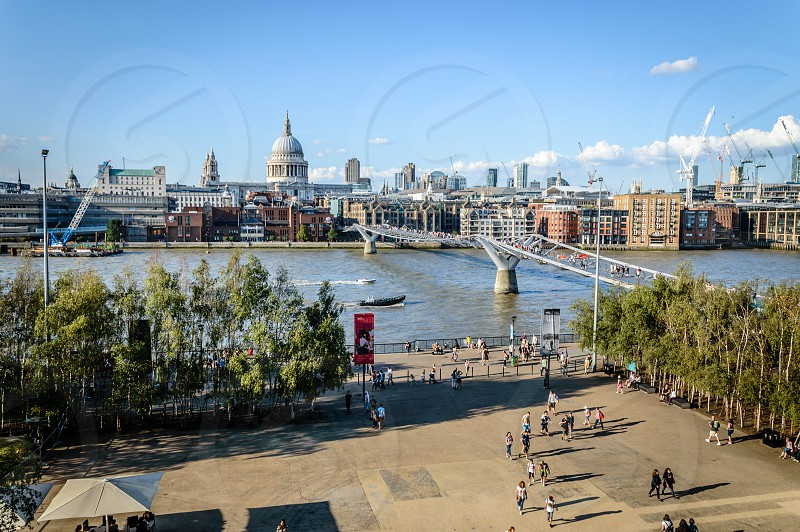 High angle view of London with Millennium bridge Thames waterfront and St Pauls Church a sunny day from Tate Modern Gallery photo