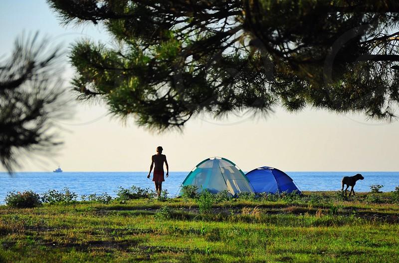 woman standing neart tent photo