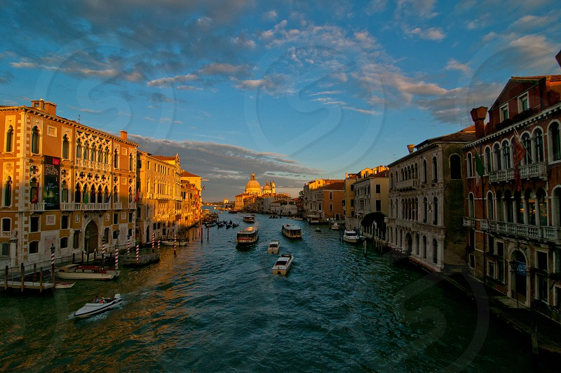 """Venice Italy grand canal view from the top of Accademia bridge with """"Madonna della Salute"""" church on background at sunset photo"""