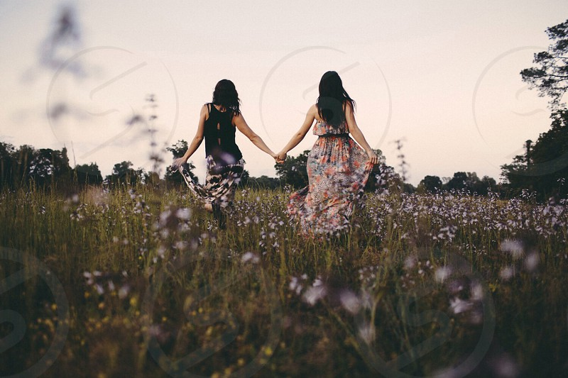 women walking on flower field modeling photography photo