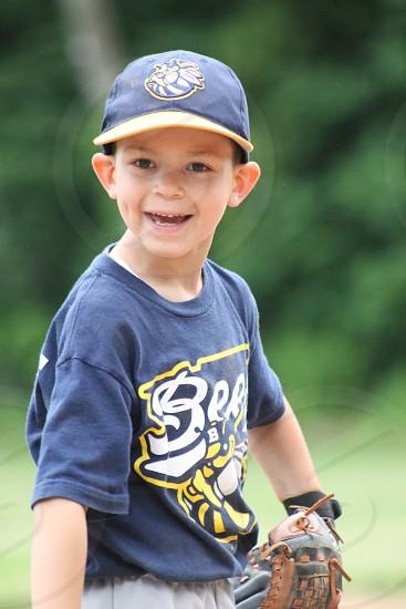 boy in bee printed black baseball jersey photo