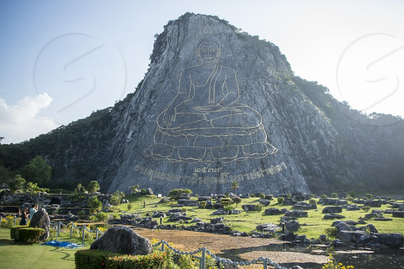 the Buddha Cliff of Khao Chee Chan at the illage of Sattahip near the city of Pattaya in the Provinz Chonburi in Thailand.  Thailand Pattaya November 2017 photo