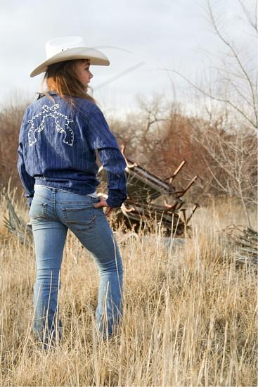 Western cowgirls farm ranch grass cowboy hat cowboy boots white hat New Mexico Albuquerque  photo