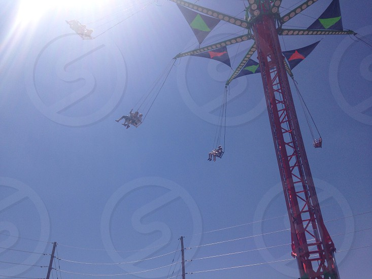 Swings at the fair/carnival.  Bright sun.  photo