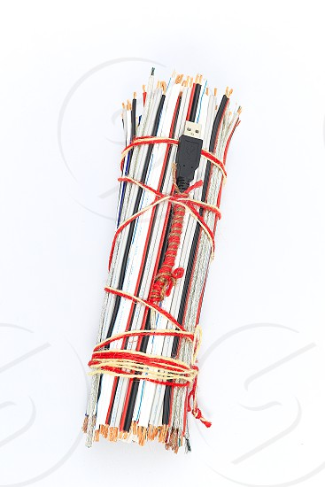 """Topic:""""Bundle of Wires"""" 14  This is an image of a bundle of electronic wires in multiple colors tied up with string with copy space and a clean white background. photo"""