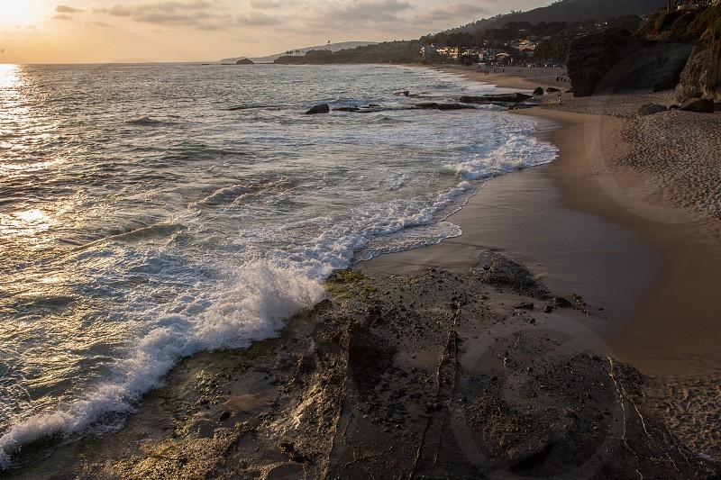 brown sand on seashore photograph photo