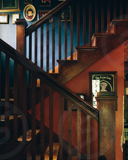 brown wooden house stairs and the al amo girl painting photo