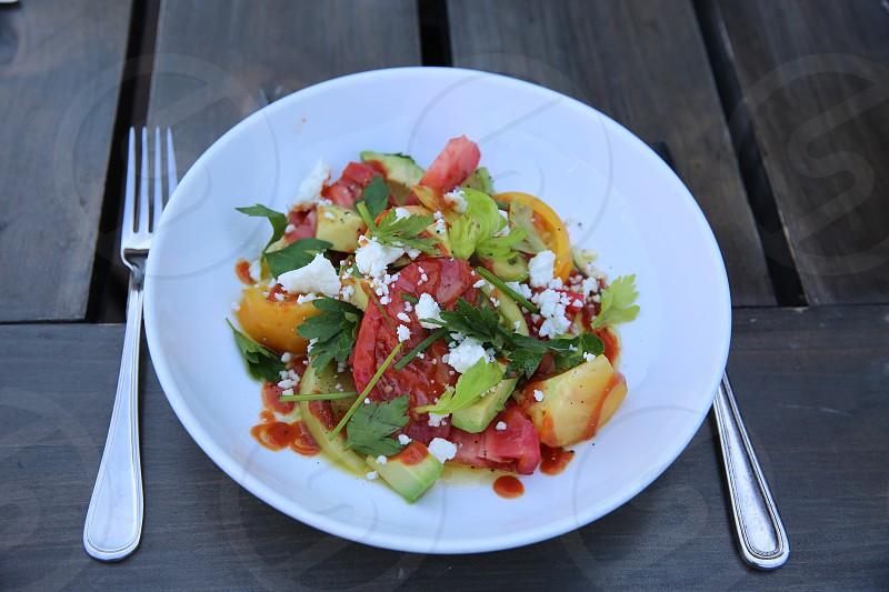veggie salad on white round plate photo