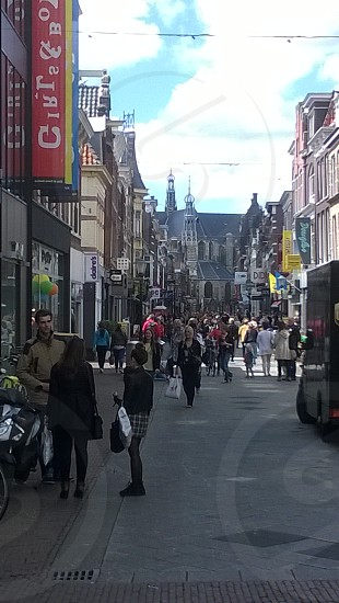 Holland Netherlands Alkmaar People Shopping Town Buildings Street Walking Talking Travel photo