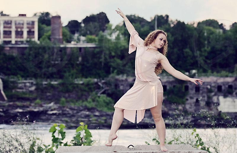 Dancer practicing in an outdoor setting. photo