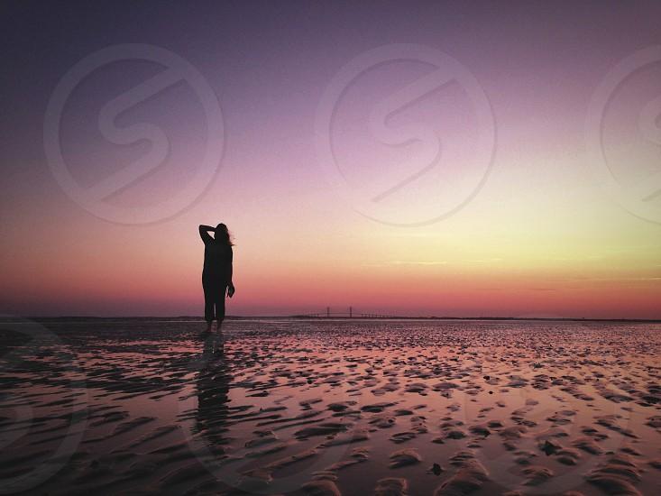 woman in seashore silhouette photo