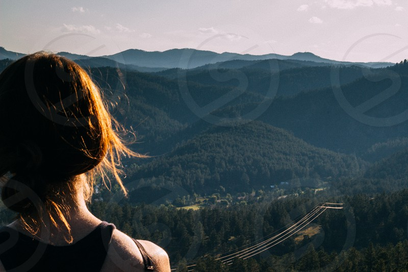 a woman looking out over the mountains photo
