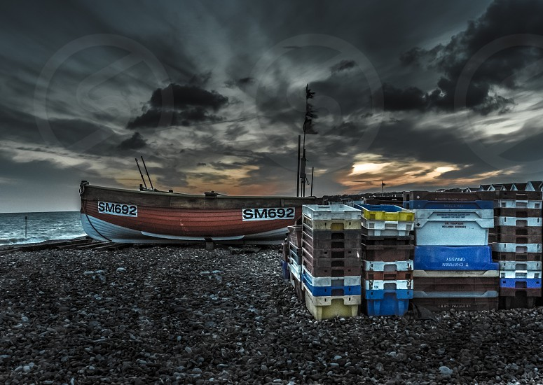 boats sunset beach fishing atmospheric photo