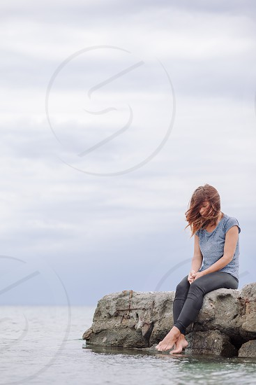 Woman alone and depressed at seaside photo